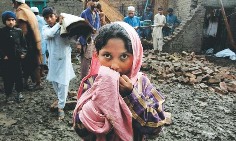 PESHAWAR: People trying to salvage on Monday what they can from a house which collapsed during the heavy rain and storm when winds reached the speed of up to 120kph on Sunday evening.—AP