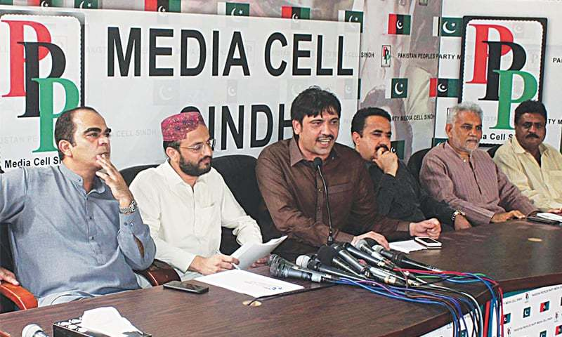 SINDH Ministers Mumtaz Jakhrani and Mukesh Chawala accompanied by MPAs Imdad Pitafi and Tariq Arain address a press conference at the PPP media cell in Karachi on Monday.—Online