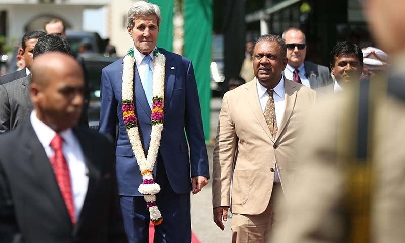 """U.S. Secretary of State John Kerry (C/L) arrives for a meeting with Sri Lankan Foreign Minister Mangala Samaraweera (C/R) at The Ministry of Foreign Affairs in Colombo on May 2, 2015.   US Secretary of State John Kerry headed for talks with Sri Lanka's new President Maithripala Sirisena on a visit that caps the island's transformation from diplomatic pariah to a """"beacon of democracy"""". —AFP"""