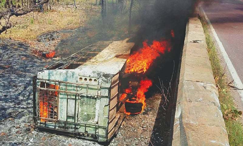 NEW DELHI: The passenger bus burns after falling into a ditch in Madhya Pradesh state.—AP