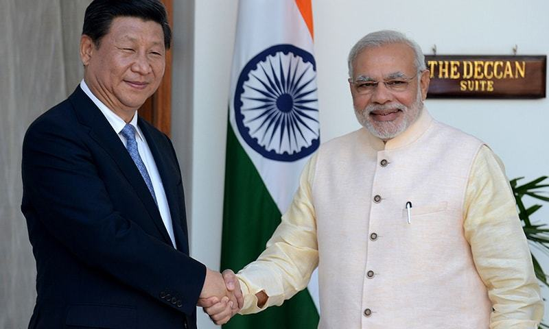 In this photograph taken on September 18, 2014, Indian Prime Minister Narendra Modi (R) shakes hands with Chinese President Xi Jinping during a meeting in New Delhi.— AFP/file