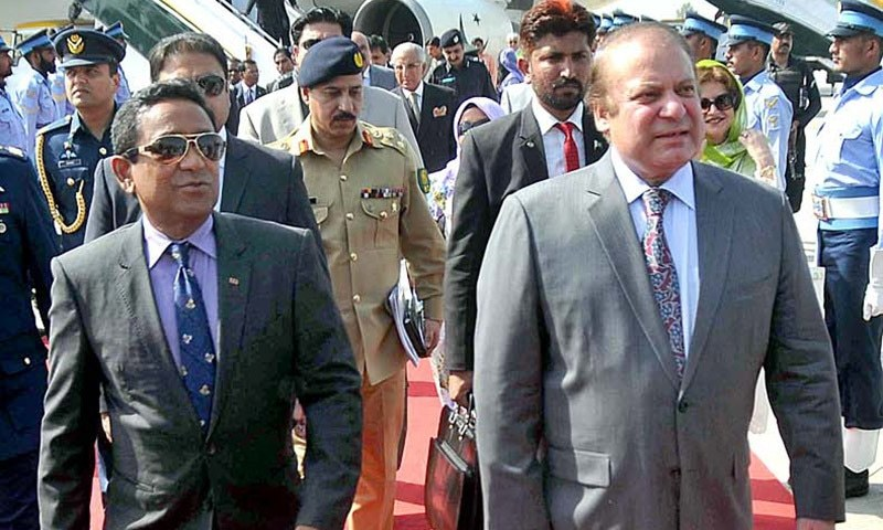 Prime Minister Mohammad Nawaz Sharif receiving President of Maldives Abdullah Yameen Abdul Gayoom upon his arrival Nur Khan Airbase.— APP