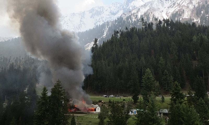 Flame and smoke rises from the site where a military helicopter crashed in  Gilgit. - AFP