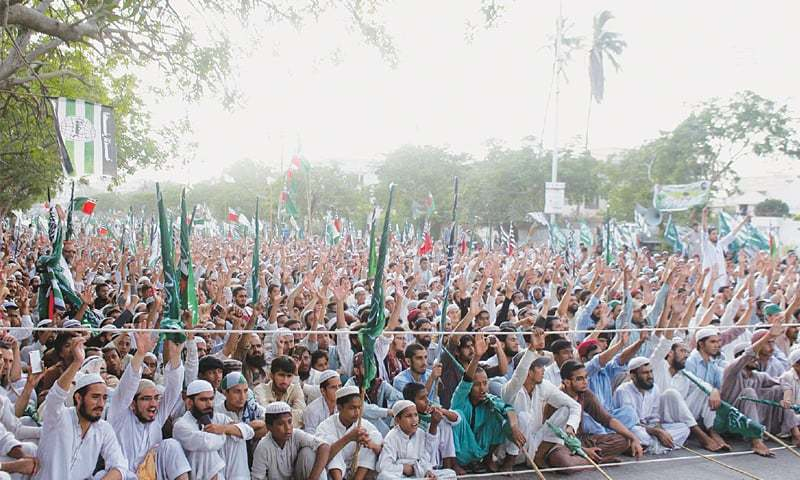 Participants in an Ahle Sunnat Wal Jamaat rally titled Tahaffuz-i-Harmain Sharifain Conference held near the Mazar-i-Quaid chant slogans on Friday.—PPI