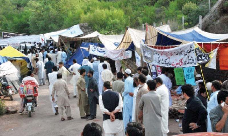 Protest camps set up outside the residence of PTI Chairman Imran Khan in Bani Gala.  — Online/file