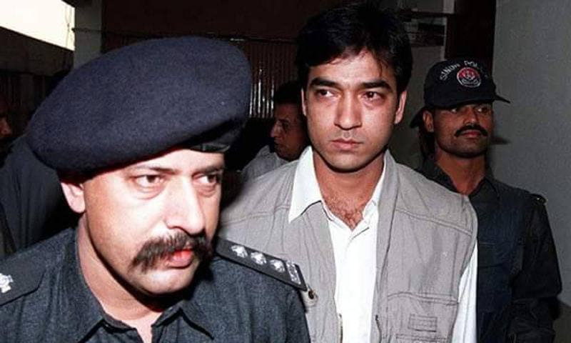 This 1998 picture shows Saulat Mirza alongside the then SHO Choudhry Aslam. ─ Nazir Shah