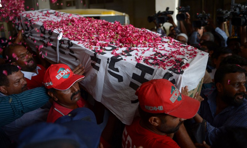 Relatives and volunteers carry the coffin of Saulat Mirza after his execution on May 12. ─ AFP