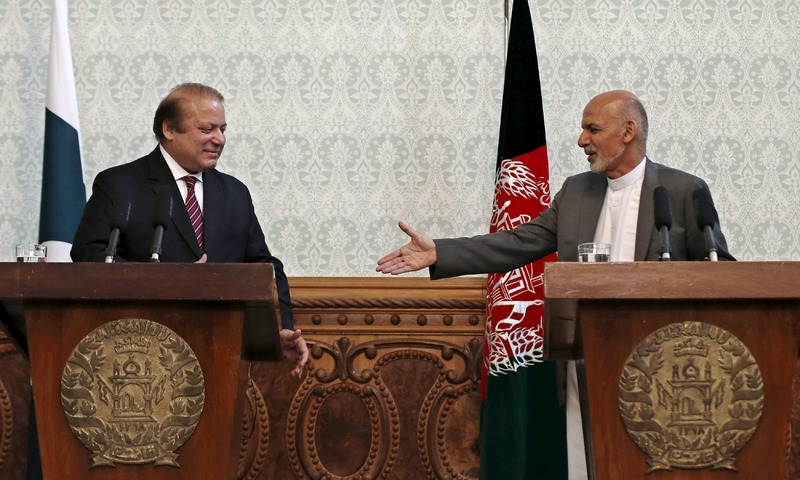 Afghan President Ashraf Ghani shakes hands with Pakistani Prime Minister Nawaz Sharif after a news conference in Kabul. -Reuters