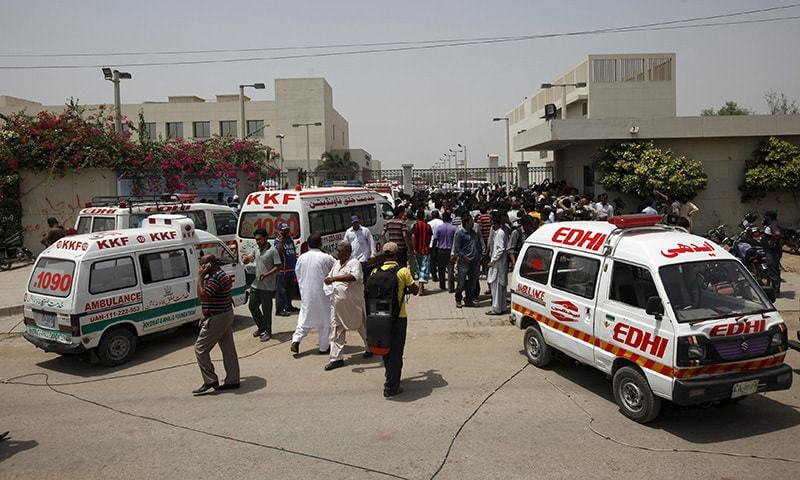 Ambulances and people gather gather outside a hospital after an attack on a bus in <a href=