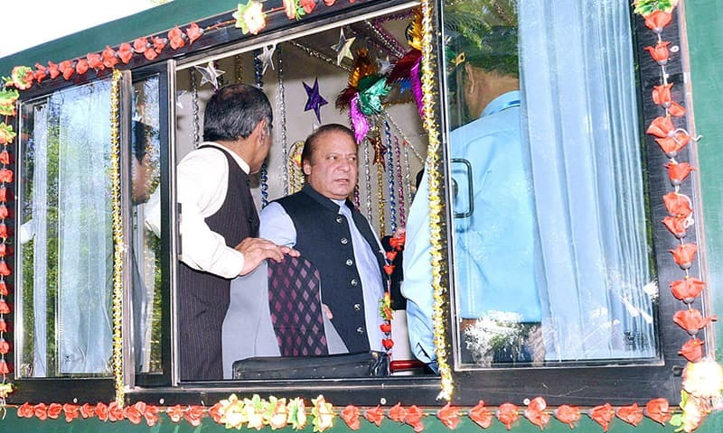 Prime Minister Nawaz Sharif being briefed about Greenline Express Train at the time of its inauguration at Margalla Railway Station. -APP