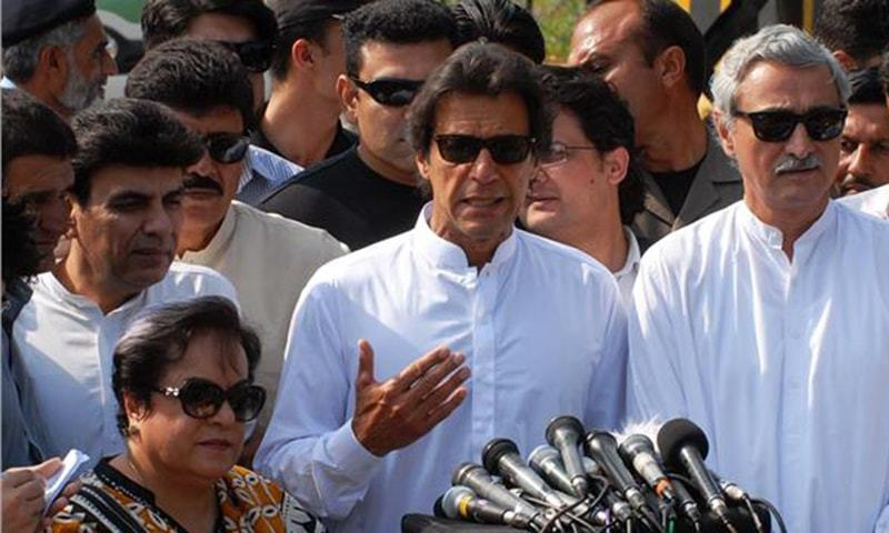 Chairman Pakistan Tehreek-e-Insaf Imran Khan talks to media persons outside Supreme Court.—Online/ Waseem Khan