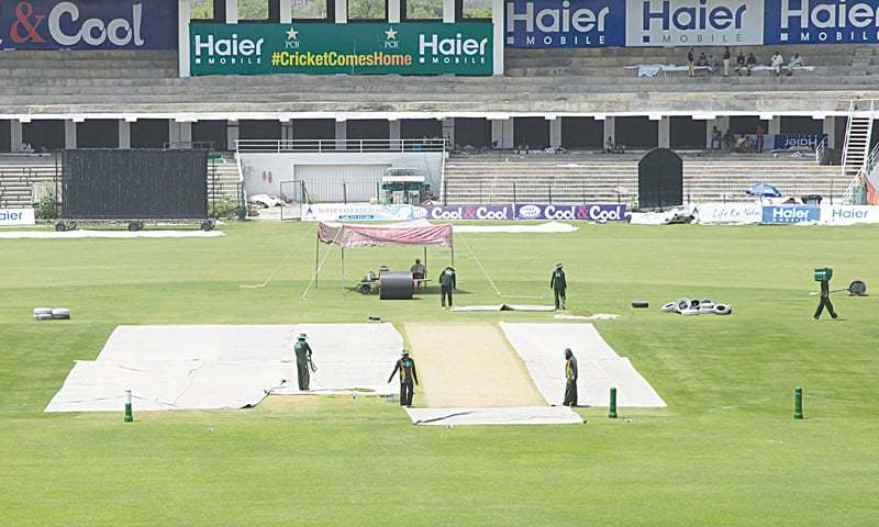 Groundsmen preparing pitches for the cricket match series against Zimbabwe at Gaddafi Stadium in Lahore. — PCB