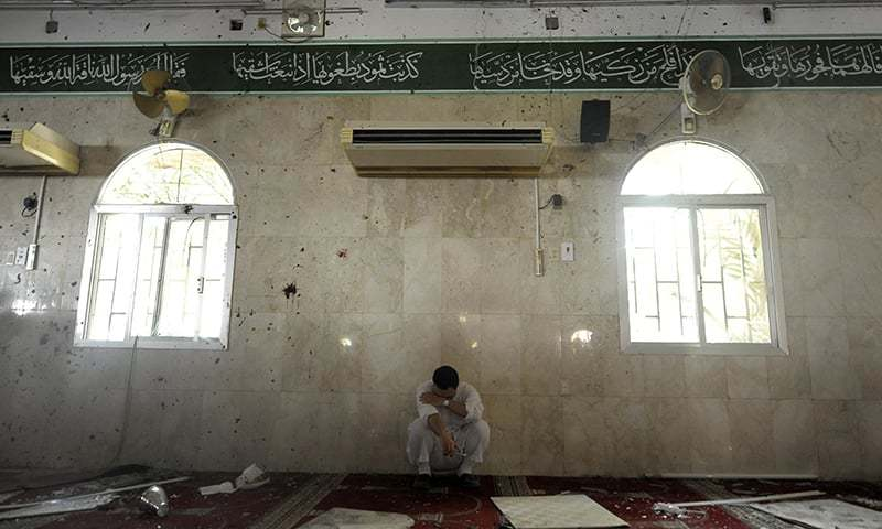 A Saudi man reacts following a blast inside a mosque of Qatif. -AFP