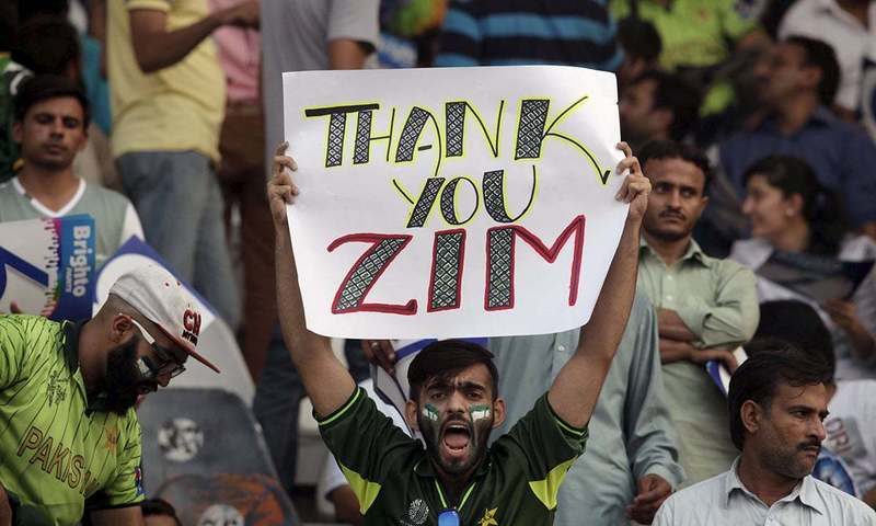 A fan holds up a placard during the T20 match between Pakistan and Zimbabwe at the Gaddafi Stadium in Lahore. — Reuters
