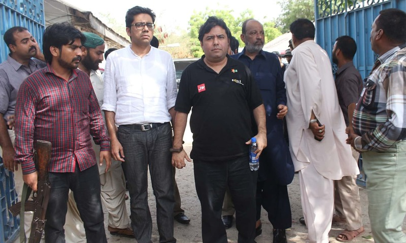 CEO of Axact Shoaib Sheikh is escorted by FIA staff. -PPI