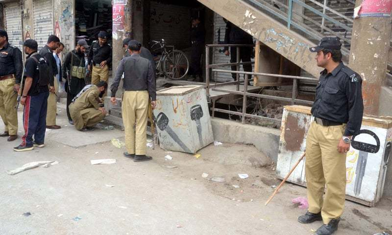 QUETTA: Security personnel cordon off the place where two persons belonging to the Shia Hazara community were shot dead while shopping in a market here on Wednesday.—PPI