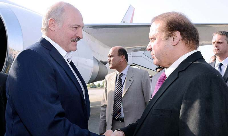 Prime Minister Nawaz Sharif welcomes the President of Belarus Alexander Lukashenko on his arrival at Nur Khan Airbase. – APP