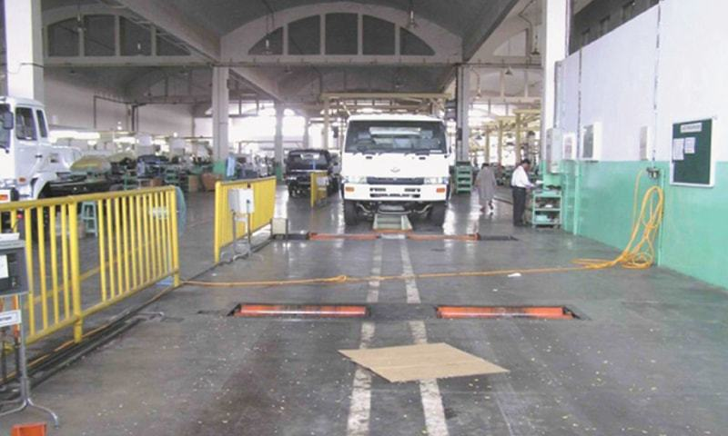 """A Dongfeng vehicle rolls down the production line. Ghandhara Nissan Ltd Chairman Raza Kuli Khan Khattak said """"the price differential of Dongfeng vehicles as compared to Japanese models will enable them to acquire a significant share in the market for heavy commercial vehicles and light commercial vehicles""""."""