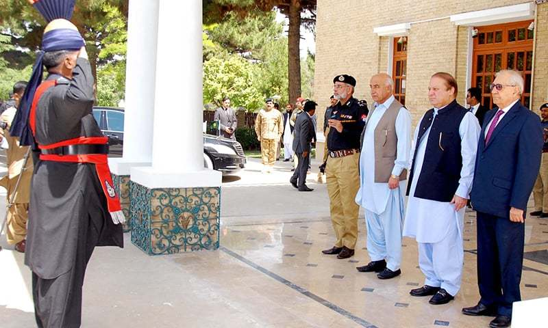 Prime Minister Nawaz Sharif is being presented  guard of honour upon his arrival at Governor House in Quetta on Tuesday. - PPI