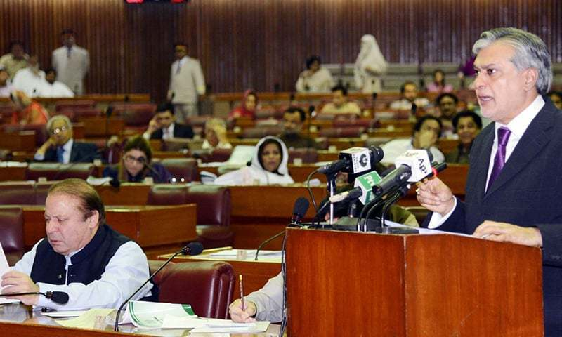 Finance Minister Ishaq Dar presenting the annual budget at the National Assembly as Prime Minister Nawaz Sharif reads a copy of the budget.- AFP