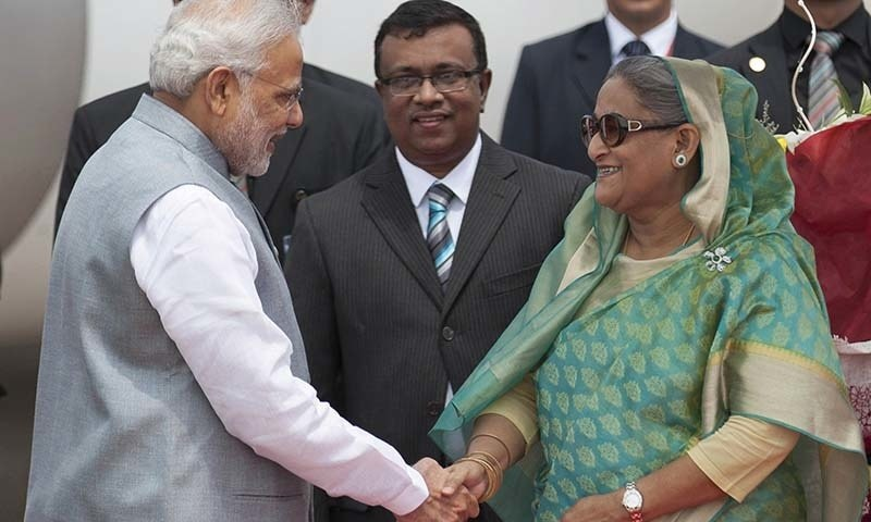 Bangladesh's Prime Minister Sheikh Hasina shakes hand with Indian Prime Minister Narendra Modi upon his arrival at the Hazrat Shahjalal International airport in Dhaka, Bangladesh, Saturday, June 6, 2015. —AP
