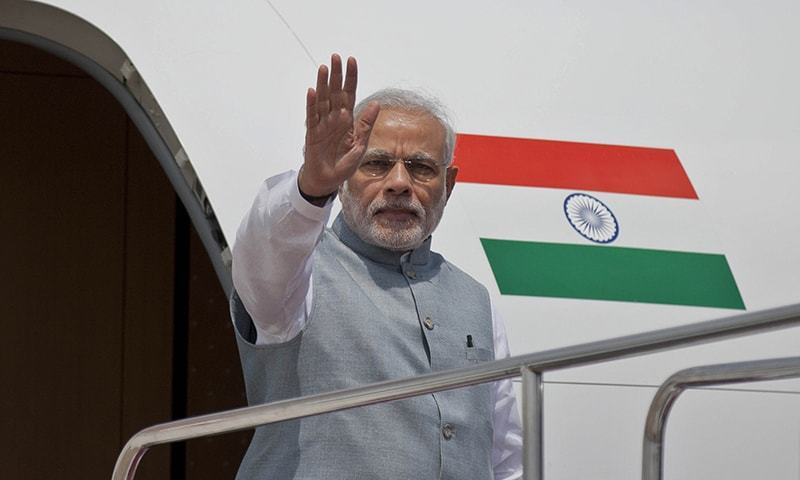 Indian Prime Minister Narendra Modi waves to the gathering upon arrival at the Hazrat Shahjalal International airport in Dhaka, Bangladesh, Saturday, June 6, 2015. -AP