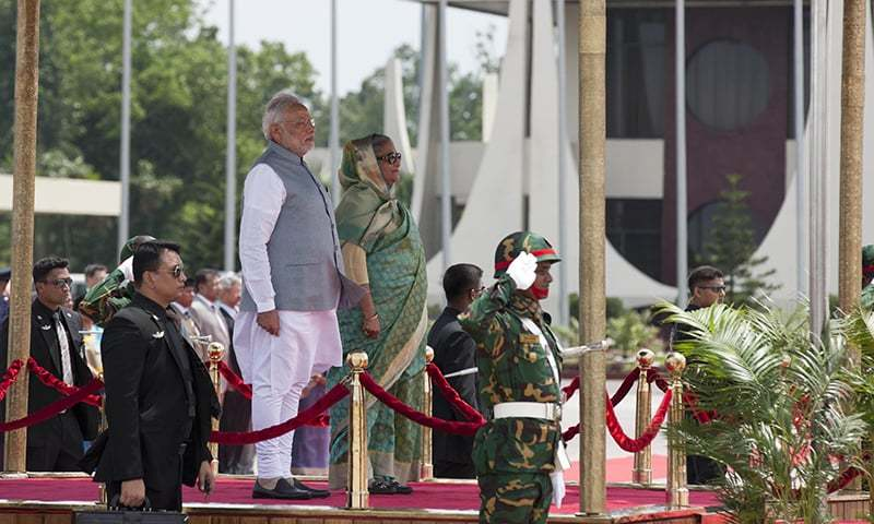 Indian Prime Minister Narendra Modi inspects a Guard of Honor, with Bangladesh's Prime Minister Sheikh Hasina by his side at the Hazrat Shahjalal International airport in Dhaka, Bangladesh, Saturday, June 6, 2015. -AP