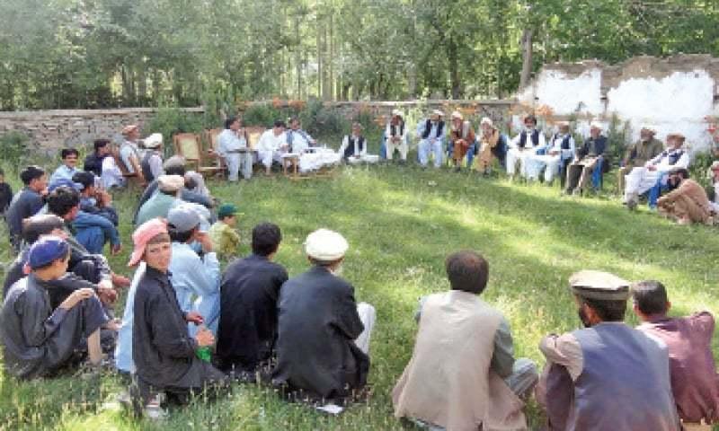 A meeting of village organisation underway in Chitral's Karimabad valley. — Dawn