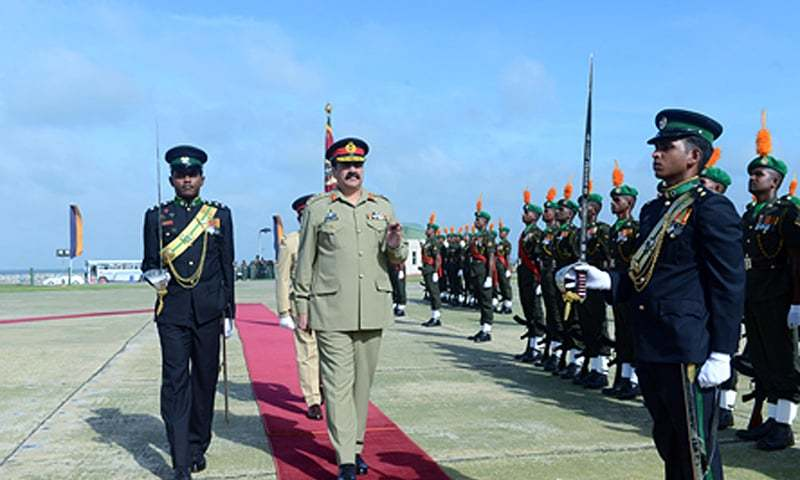 COAS General Raheel Sharif reviewing guard of honour on his arrival at Army Headquarters in Srilanka. — APP