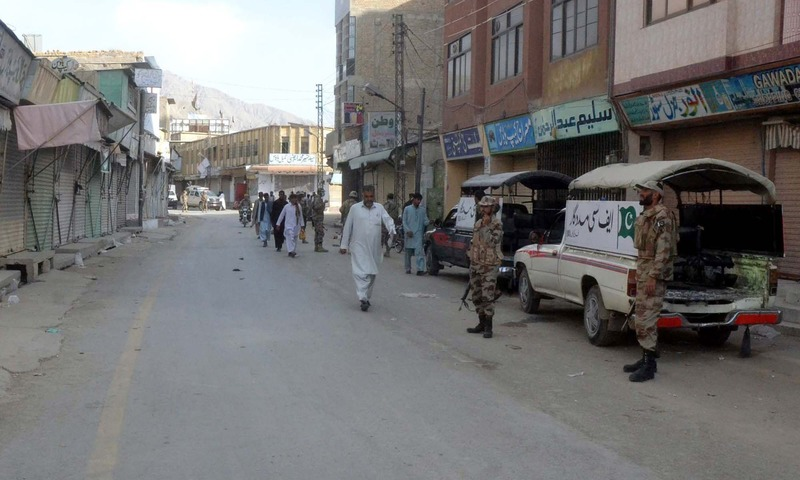 Security officials stand alert at site after firing incident at Circular road in Quetta. - PPI