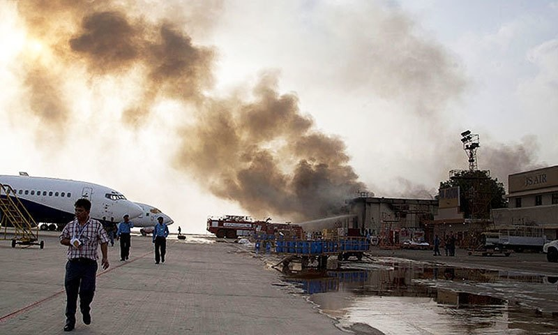 Smoke rising from the Jinnah International Airport in Karachi after an attack on June 8, 2014. —AP