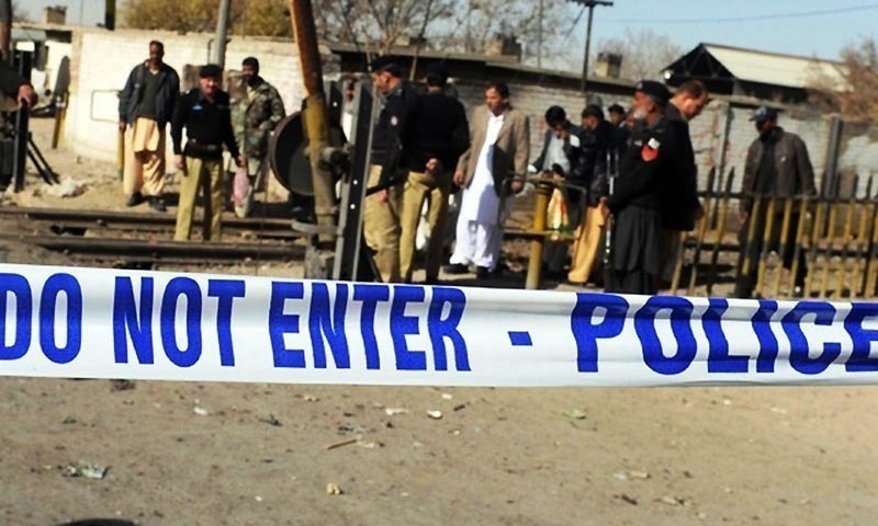 Policemen inspecting a cordoned off crime site in Quetta. - AFP/File