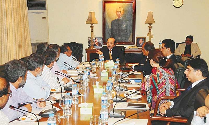 CHIEF Minister Syed Qaim Ali Shah presides over a meeting of Karachi industrialists at CM House on Thursday.—Online