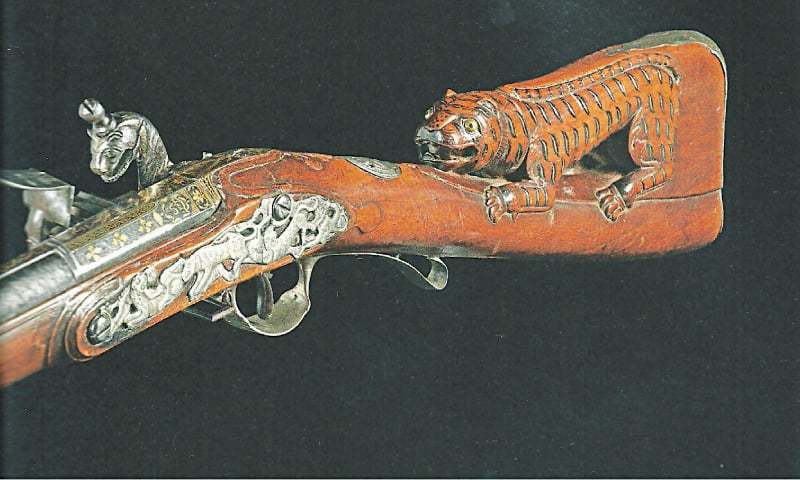 An ornately carved rifle / Photo by the writer