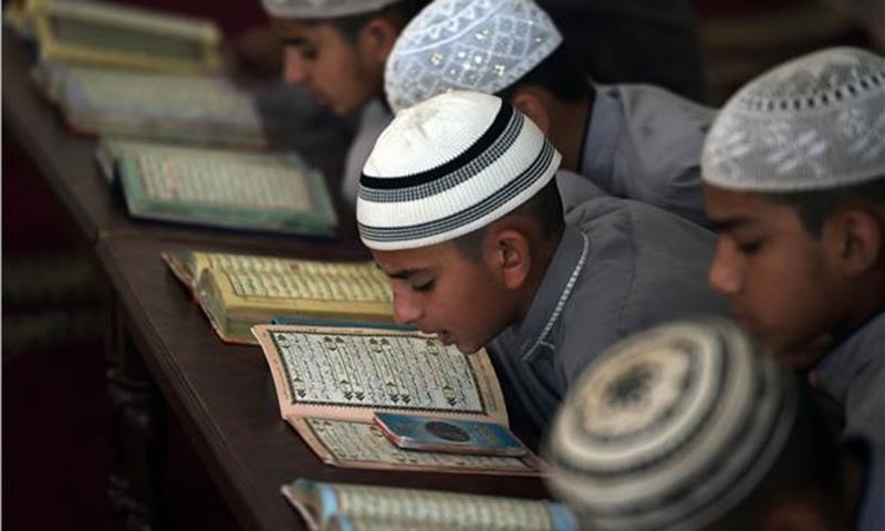 Pakistani students of a madrassah at their seminary in Islamabad. - AFP