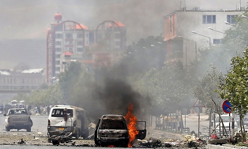 A vehicle is seen on fire after a blast near the Afghan parliament in Kabul. ─ Reuters