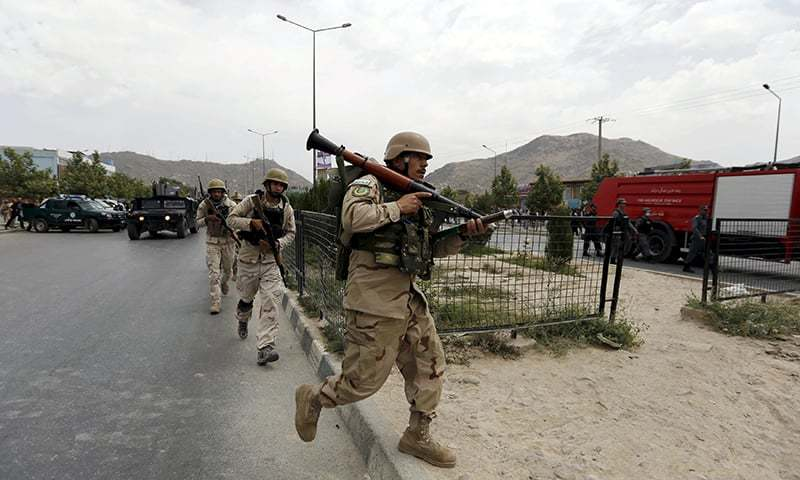 Afghan security forces arrive at the site of an attack near the parliament. ─ Reuters