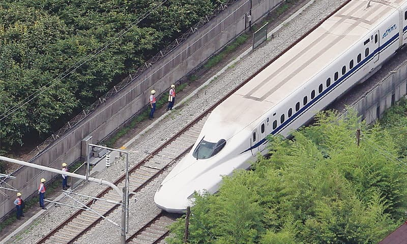 TOKYO: An aerial view of the stationary bullet train after the apparent suicide attempt.—AFP