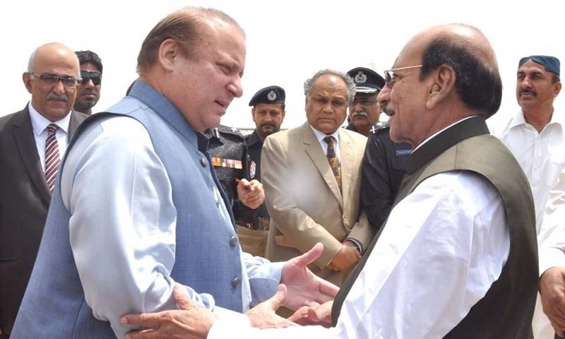 CM Sindh Qaim Ali Shah receives PM Nawaz at Karachi airport. —PID