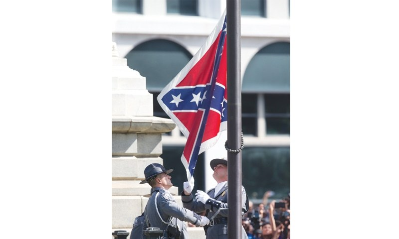 an argument in favor of the confederate flag above the capitol building in columbia south carolina A confederate flag outside the south carolina state house in columbia, south carolina.