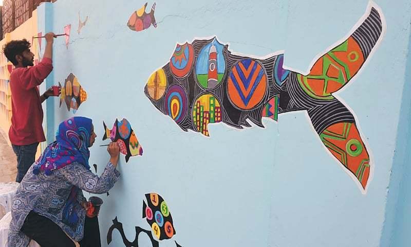 Artists reclaim Karachi walls from hate graffiti ...
