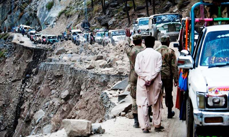 Drivers are backed up on a damaged road to reach Mingora, Pakistan, from Kalam, in Pakistan's Swat Valley. —AP