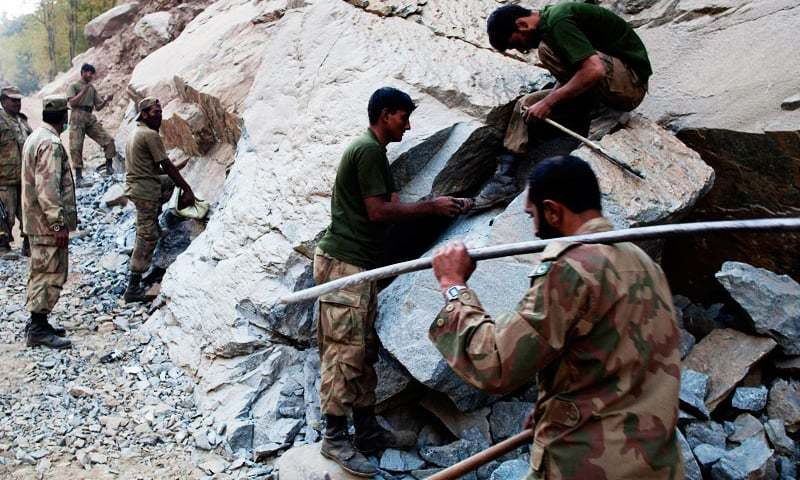 Pakistan Army soldiers set up explosives to make an alternate road in Kalam, Nov 2010. —AP