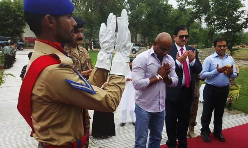 Former Sri Lankan captain pays his respects to the victims of the terrorist attack on the Army Public School during a visit to Peshawar. '— Photo courtesy Sanath Jayasuriya's official Facebook page