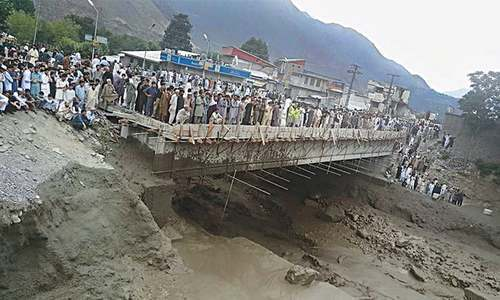 A bridge in Chitral damaged by flood on Thursday. – Dawn/File Photo