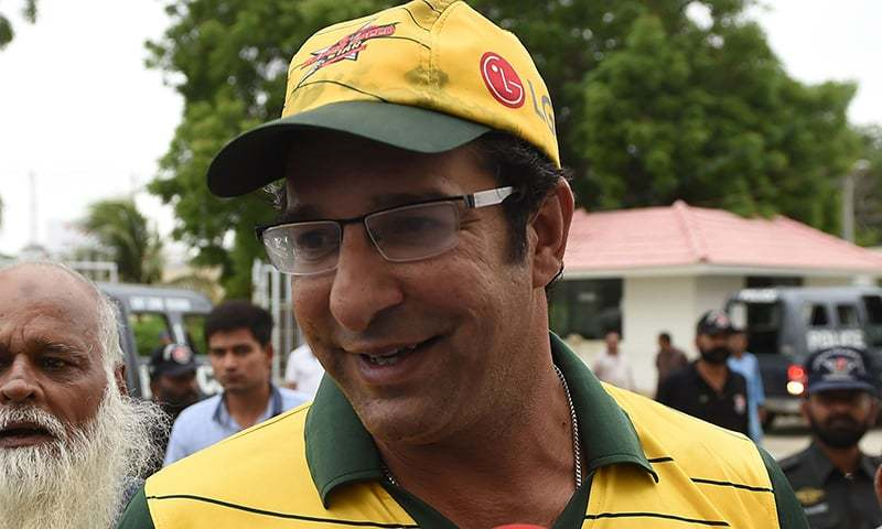 Wasim Akram talks to media as he arrives at the National Cricket Stadium in Karachi on August 5, 2015, after a gunman opened fire on his car.  – AFP