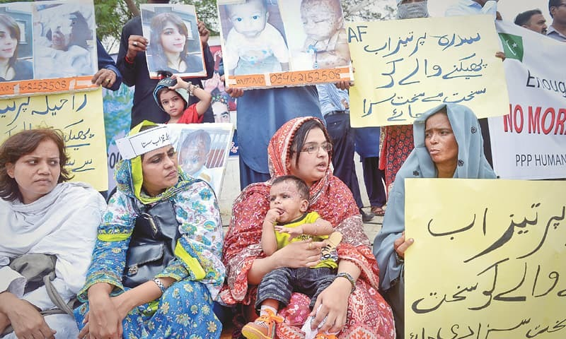 FAMILIES of acid attack victims and civil society activists protest near the Sindh Assembly building on Friday.—White Star