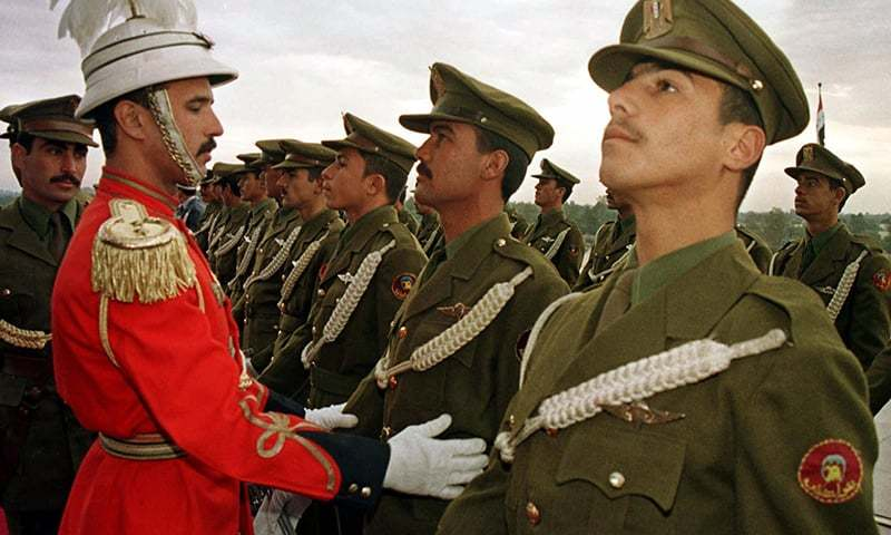 FILE - In this Jan. 6, 1999 photo, an Iraqi officer prepares his soldiers before the Army Day ceremony at the Unknown Soldier monument to celebrates the 78th anniversary of their army foundation in Baghdad, Iraq. — AP/file