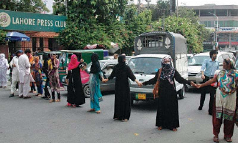 Candidates for lady constable slots protest outside the Lahore Press Club. — Online
