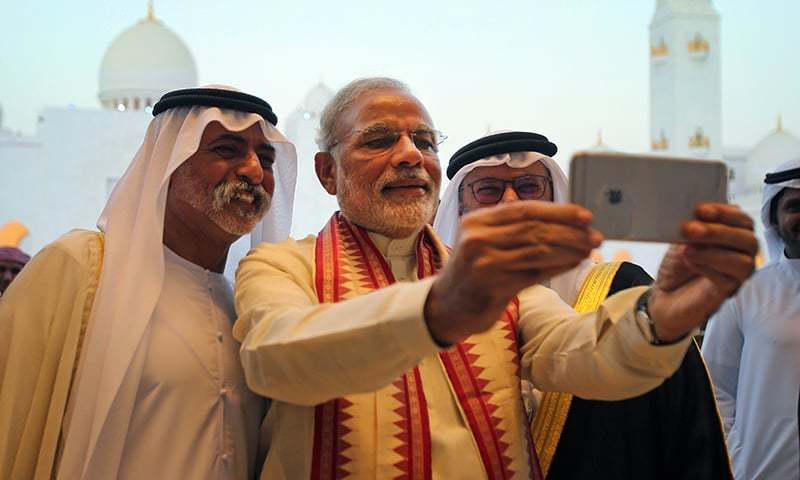 Indian PM Modi takes a selfie next to Sheikh Hamdan bin Mubarak Al Nahyan, UAE Minister of Higher Education and Scientific Research (L) as they tour the Sheikh Zayed Grand Mosque during the first day of his two-day visit to the UAE. ─ AP